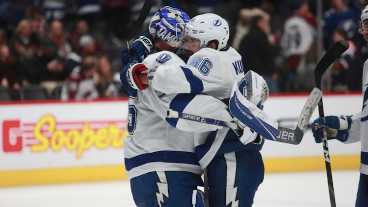 Tampa Bay Lightning's Nikita Kucherov (#86) and goalie Curtis McKelhinney (#35) celebrate a goal against the Colorado Avalanche at the Pepsi Center in Denver, Colorado on Monday, February 17, 2020. Photo: NHL.