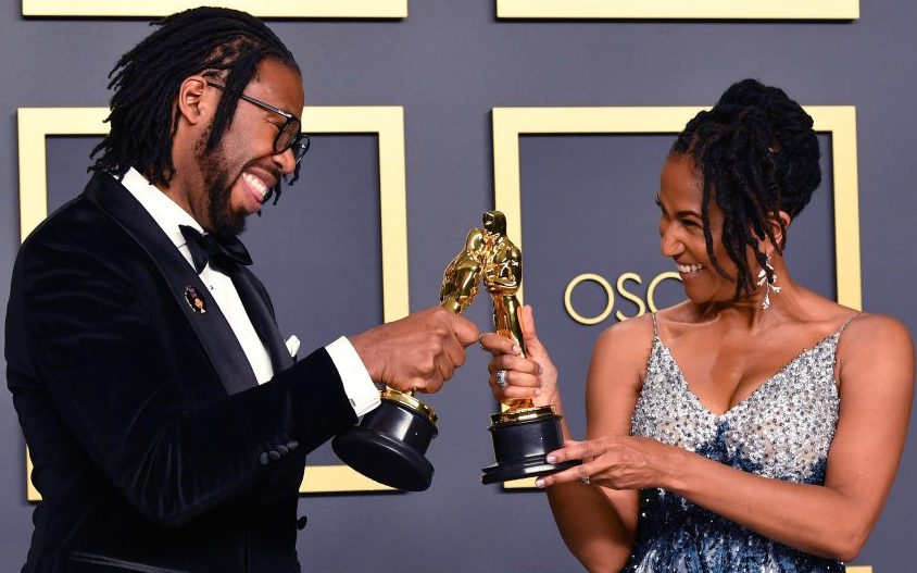 "Matthew A. Cherry and Karen Rupert Toliver celebrate receiving their first Oscar (Short Film, Animated) for ""Hair Love."""