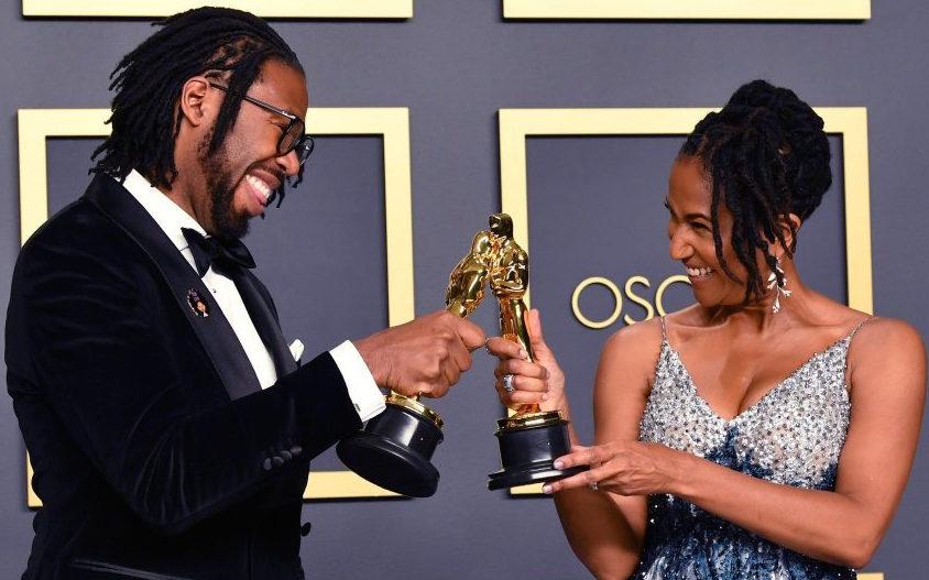 "Matthew A. Cherry and Karen Rupert Toliver celebrate receiving their first Oscar (Short Film, Animated) for ""Hair Love."""