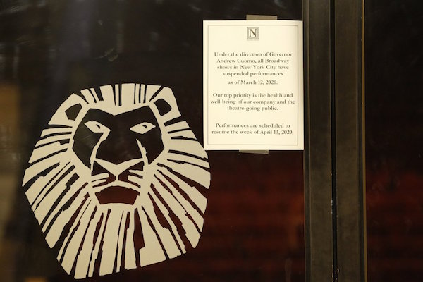 """A sign announcing the suspension of all Broadway shows is posted on a door at the Minskoff Theatre, where """"The Lion King"""" had been playing, Thursday, March 12, 2020, in New York. Gov. Andrew Cuomo banned gatherings of more than 500 people. (AP Photo/Kathy Willens)"""