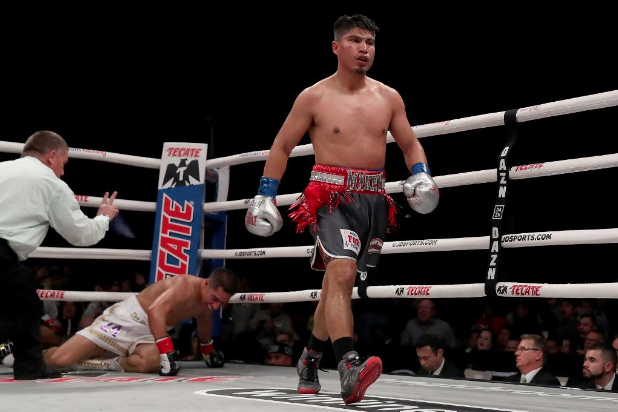 Mikey Garcia knocks down Jessie Vargas in the fifth round during their WBC Welterweight Diamond Championship bout at The Ford Center at The Star on February 29, 2020 in Frisco, Texas. Tom Pennington/Getty Images/AFP