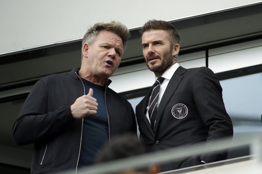 David Beckham, right, talks to chef Gordon Ramsay before an MLS soccer match between Los Angeles FC and Inter Miami CF Sunday, March 1, 2020, in Los Angeles. (AP Photo/Marcio Jose Sanchez)