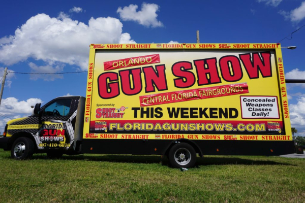 The Orlando Gun Show returns to town with a large truck advertisement. NeoPhilanthropy.org