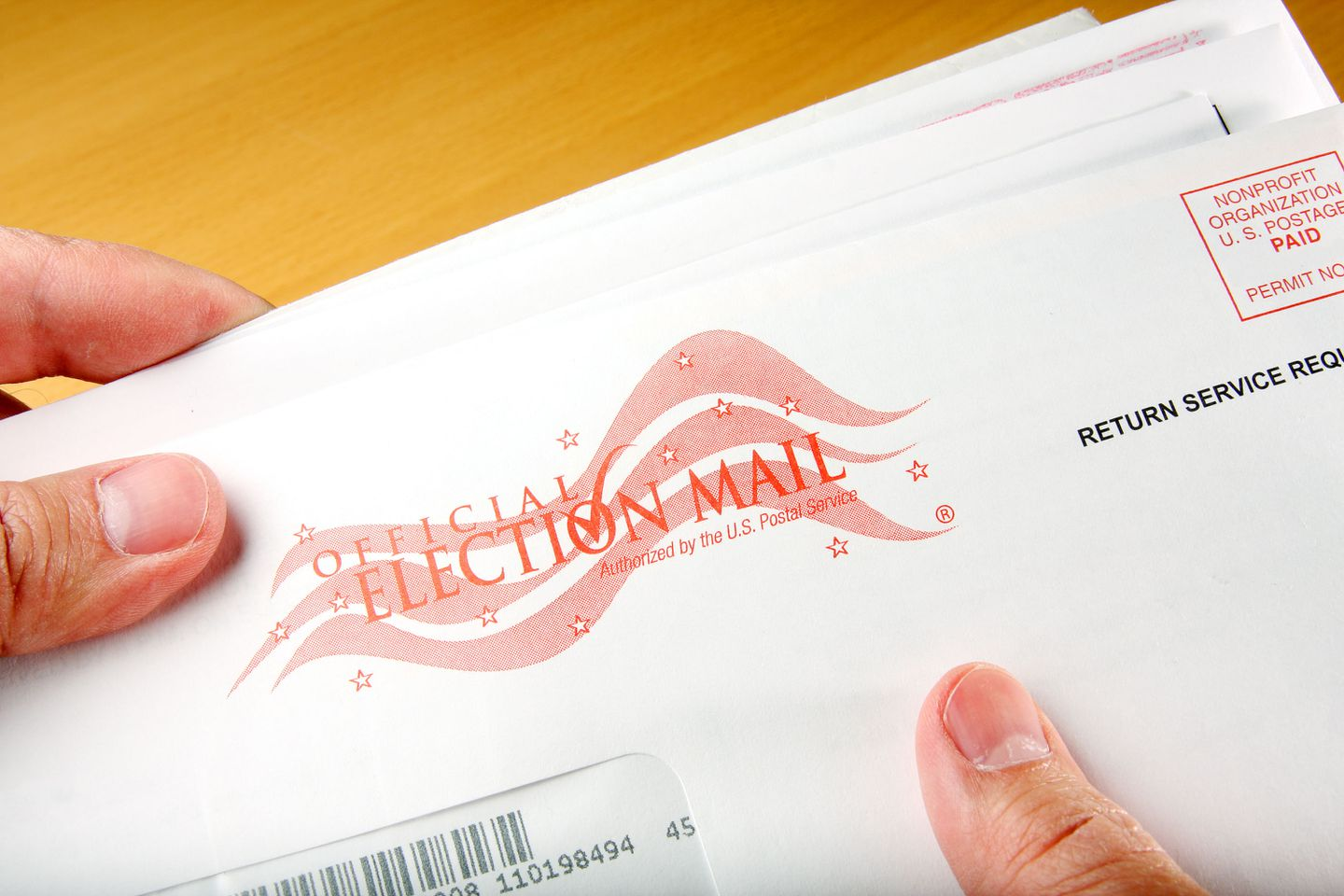 A voter receives a sample election ballot in the mail. Image via Adobe.