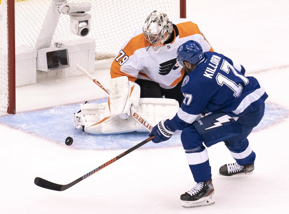 Philadelphia Flyers goaltender Carter Hart (79) makes a save on Tampa Bay Lightning left wing Alex Killorn (17) during the first period of an NHL hockey playoff game Saturday, Aug. 8, 2020, in Toronto. (Frank Gunn/The Canadian Press via AP)