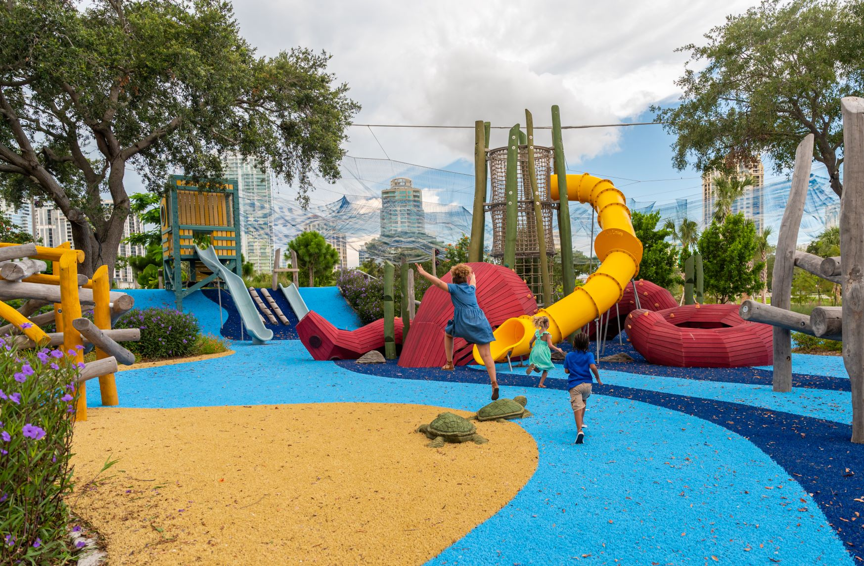Children frolic at the City of St. Petersburg's pier playground, now officially named The Glazer Family Playground, with the skyline backdrop. Photo: City of St. Petersburg.