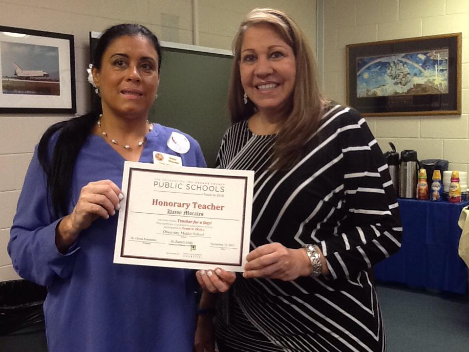 Orange Soil & Water Conservation District Supervisor Daisy Morales receives a certificate of appreciate as Teacher for a Day at East River High School in November 2018. Image courtesy of Daisy Morales (Facebook).