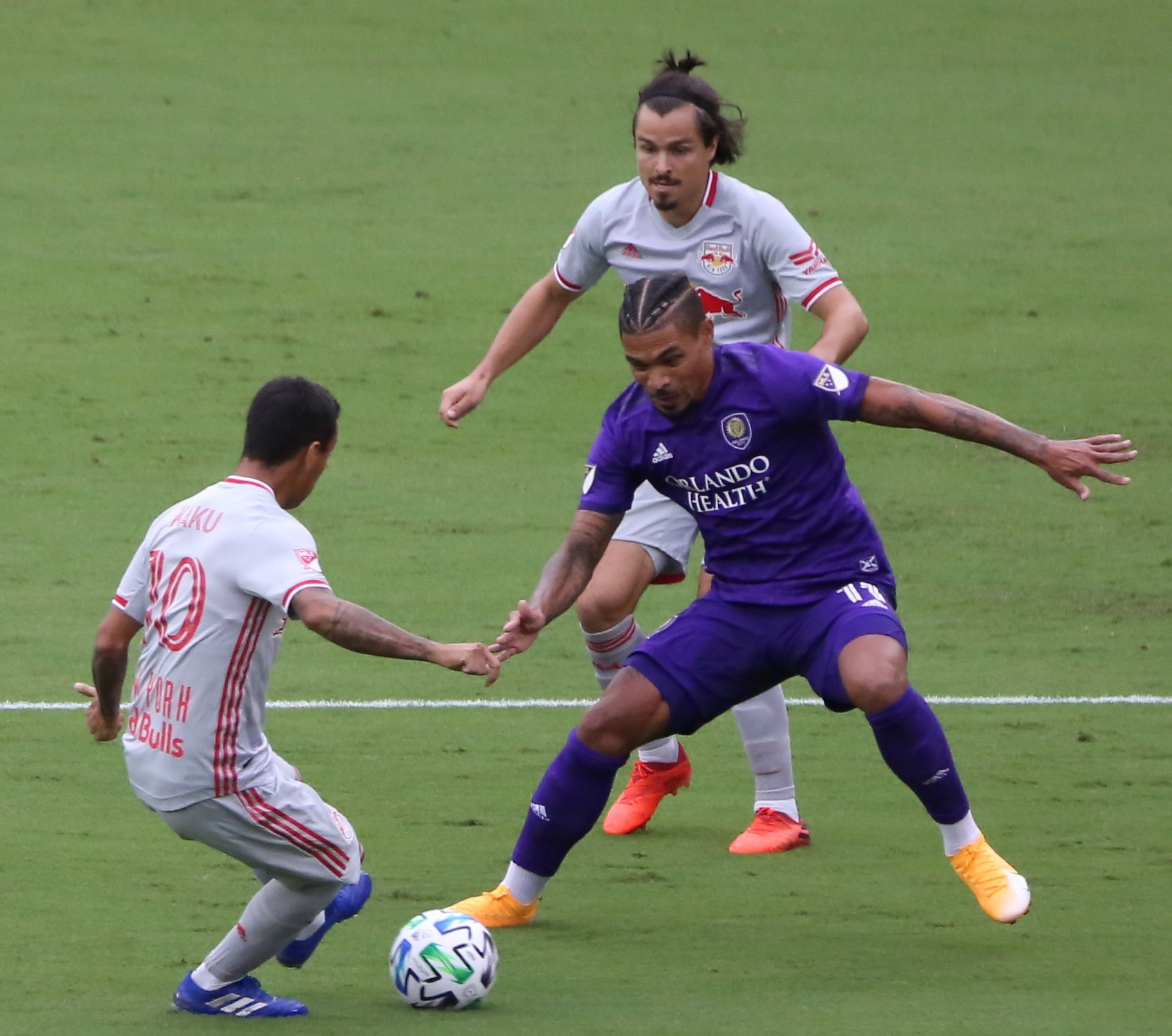 Orlando City SC's Junior Urso (in purple) scored for the Lions with an assist from Chris Mueller in the 50th minute against the New York Red Bulls at Exploria Stadium Saturday. Photo: Willie David / Florida National News.