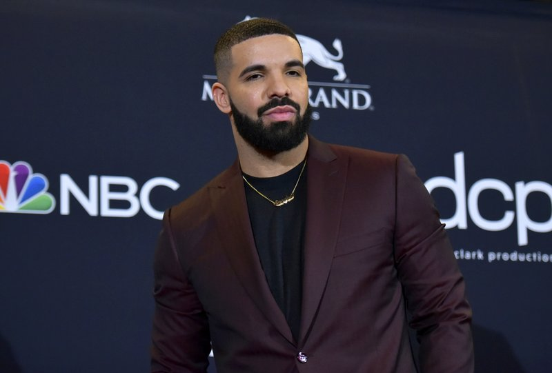 "FILE - This May 1, 2019 file photo shows Drake at the Billboard Music Awards in Las Vegas. Earning his 21st No. 1 hit on Billboard's R&B/Hip-Hop songs chart, Drake has bested a record previously held by icons Aretha Franklin and Stevie Wonder. Drake's ""Laugh Now Cry Later,"" featuring rapper Lil Durk, reached the No. 1 spot on the chart this week. Wonder and Franklin, who died in 2018, each have had 20 songs top the chart. (Photo by Richard Shotwell/Invision/AP, File)"