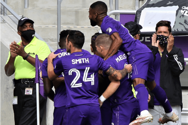Orlando City SC forward Ruan Texeira (atop) celebrates with his teammates after Orlando scores a penalty kick during Orlando City's Audi MLS Cup Playoffs debut at Exploria Stadium Saturday, November 21, 2020. Photo: Willie David/Florida National News.