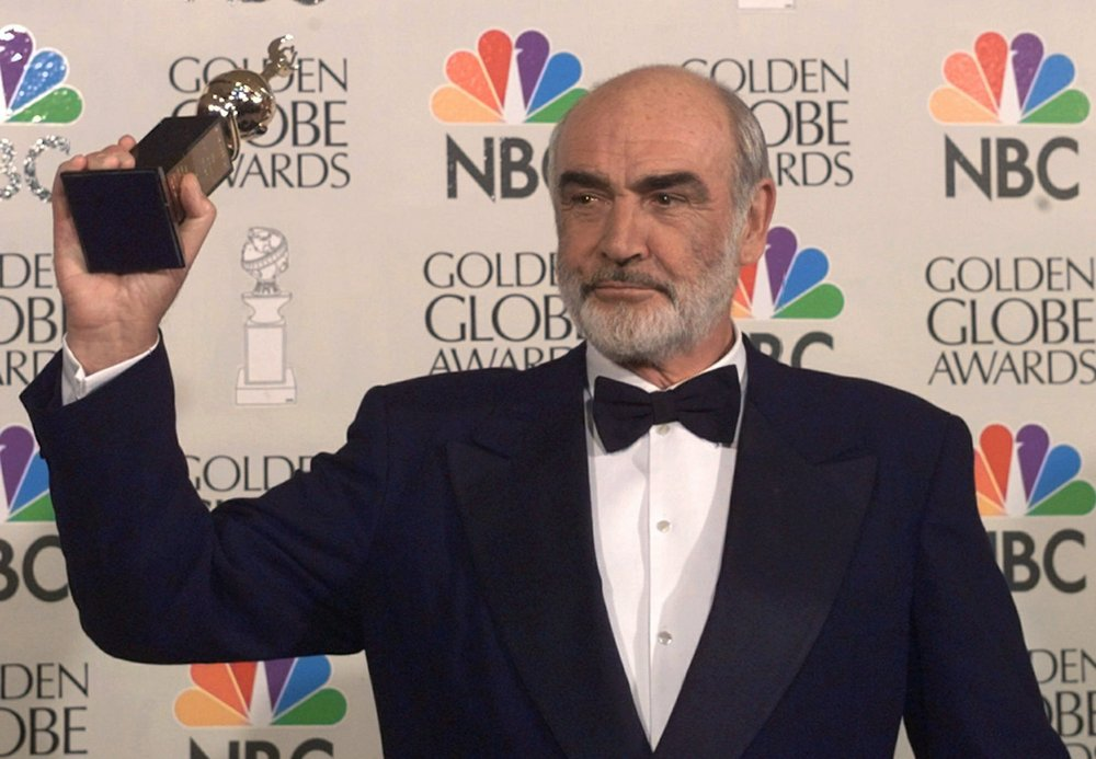 FILE - In this file photo dated Sunday, Jan. 21, 1996, Sean Connery is honored at the Golden Globe Awards, in Beverly Hills, Calif., USA, when he received the Cecil B. DeMille Award. Scottish actor Sean Connery, considered by many to have been the best James Bond, has died aged 90, according to an announcement Saturday Oct. 31, 2020, from his family. (AP Photo/Mark J. Terrill, FILE)