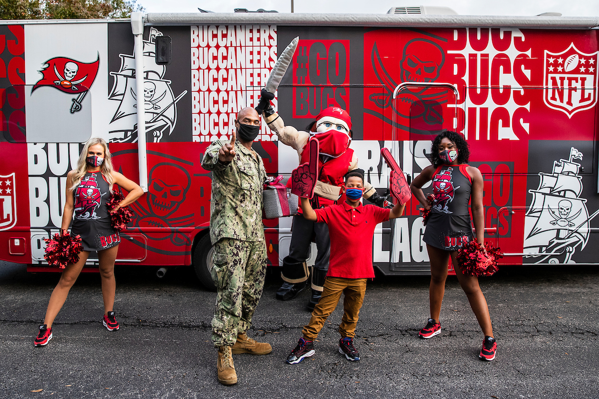 TAMPA, FL - DECEMBER 14, 2020 - Recipients of the Schwarzkopf Military Family of the Year are presented with an award, gifts and a video with special appearances from Tampa Bay Buccaneers Cheerleaders and Captain Fear. Photo By Tori Richman/Tampa Bay Buccaneers.