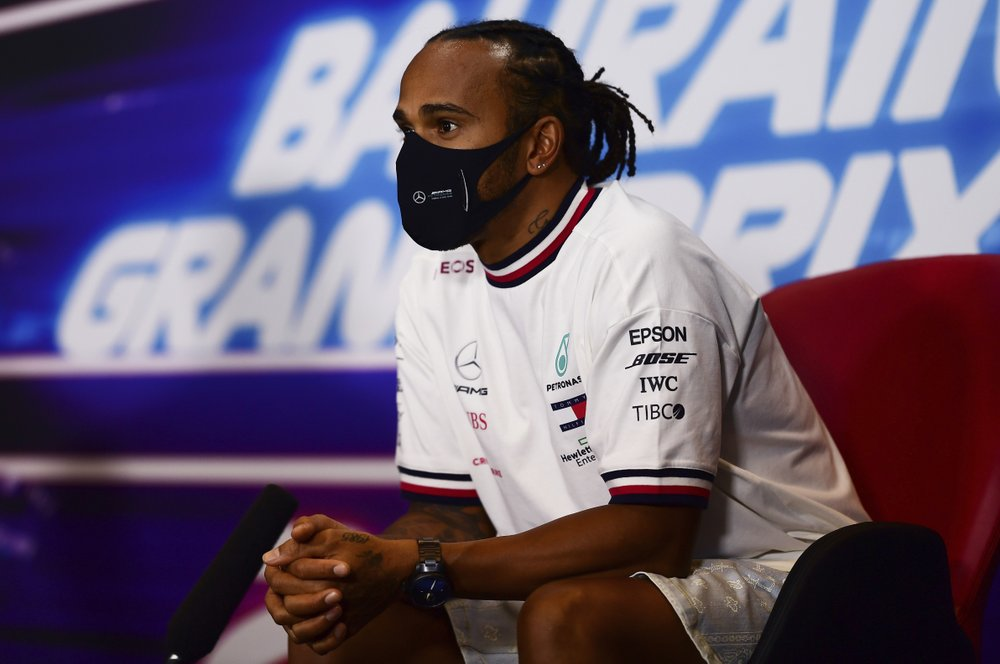 FILE - In this Thursday, Nov. 26, 2020 file photo Mercedes driver Lewis Hamilton of Britain participates in a media conference prior to the Bahrain Formula One Grand Prix at the International Circuit in Sakhir, Bahrain. The Bahrain Formula One Grand Prix will take place on Sunday. World champion Lewis Hamilton tested positive for COVID-19 and will miss the Sakhir Grand Prix this weekend, his Mercedes-AMG Petronas F1 Team said Tuesday Dec. 1, 2020. (Mario Renzi, Pool via AP, File)