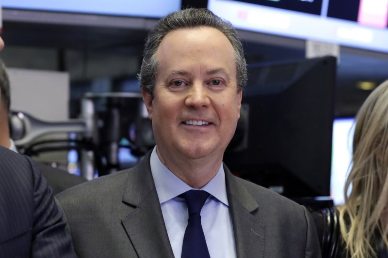 FILE - In this April 28, 2016 file photo, S&P Global CEO Douglas Peterson poses for photos on the floor of the New York Stock Exchange, after ringing the opening bell. S&P Global is buying IHS Markit in a $44 billion all-stock deal that brings together two of the largest data providers to Wall Street. Peterson will hold his title at the combined company. (AP Photo/Richard Drew, File)