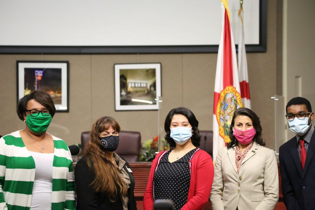 FILE - Then Orange Soil & Water Conservation Board Acting Chair and Seat 4 Supervisor Dawn Curtis (left) welcomes the newly sworn in Supervisors Karolyn Campbell (Seat 2), Raquel Lozano (Seat 3), Alaina Slife (Seat 5), and Nathaniel Douglas (Seat 1) at the Orange County Board of County Commission Chamber Monday, December 28, 2020. (Photo by J Willie David, III/Florida National News).
