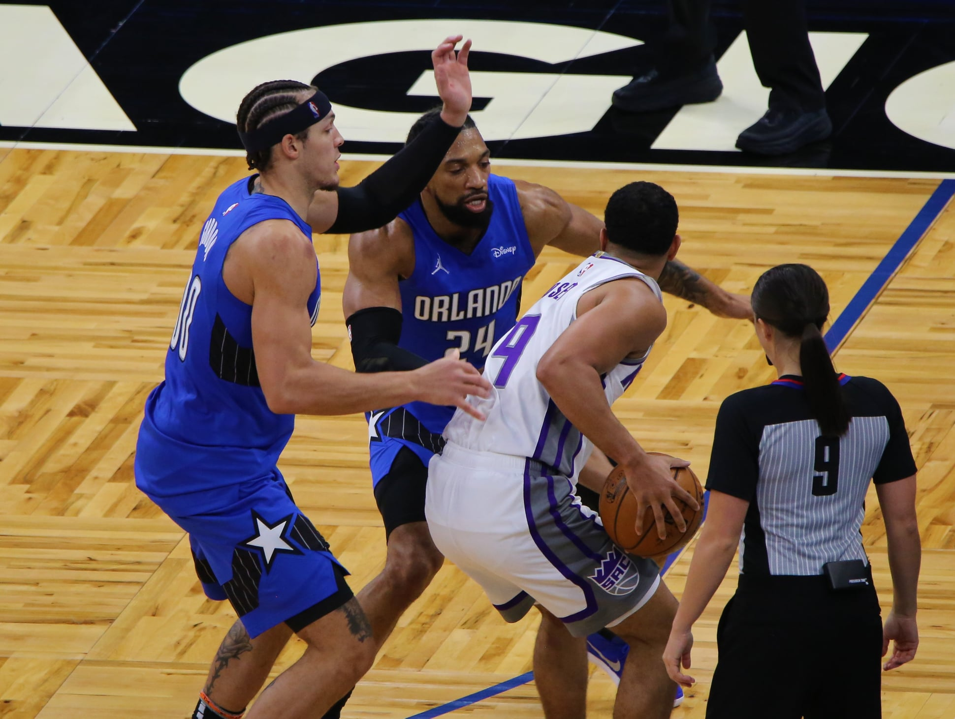 Khem Birch (center) and Aaron Gordon (left) apply pressure during their matchup against the Sacramento Kings at Amway Center Wednesday, January 27, 2021. Photo: J. Willie David III/Florida National News.