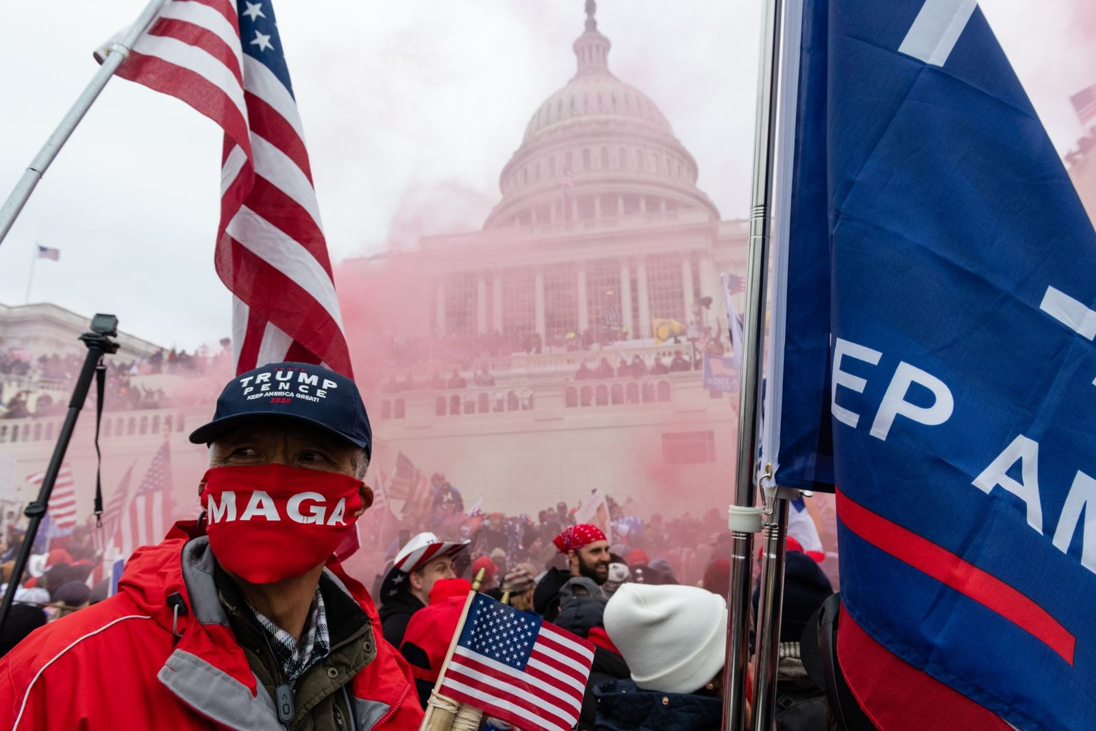 Smoke grenade goes off at insurrection led by supporters of President Trump, Washington, D.C., January 6, 2021. Photo by Eric Lee/Bloomberg.