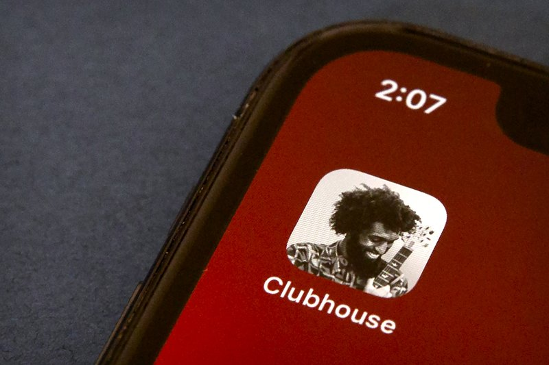 The icon for the social media app Clubhouse is seen on a smartphone screen in Beijing, Tuesday, Feb. 9, 2021. Clubhouse, an invitation-only audio chat app launched less than a year ago, has caught the attention of tech industry bigshots like Tesla CEO Elon Musk and Facebook CEO Mark Zuckerberg, not to mention the Chinese government, which has already blocked it in the country. (AP Photo/Mark Schiefelbein)