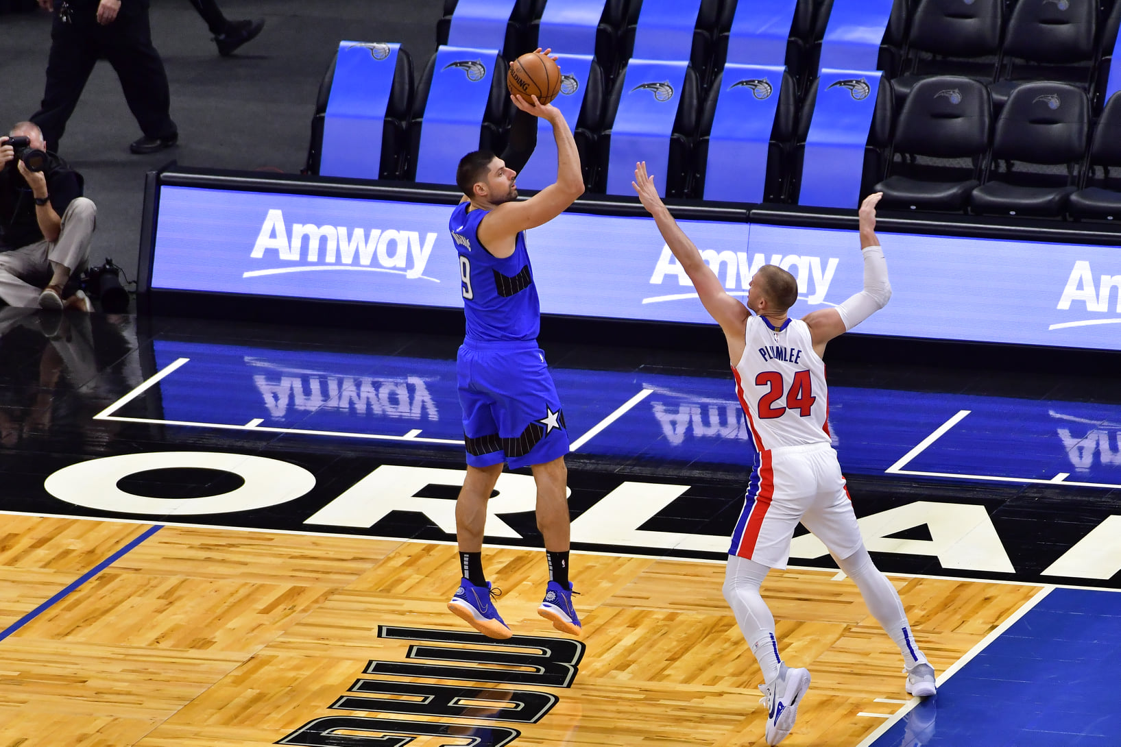 Orlando Magic center Nicola Vucevic (left) makes a shot during the Magic's match against the Detroit Pistons Sunday, February 21, 2021. Photo: Harry Castiblanco/Florida National News.