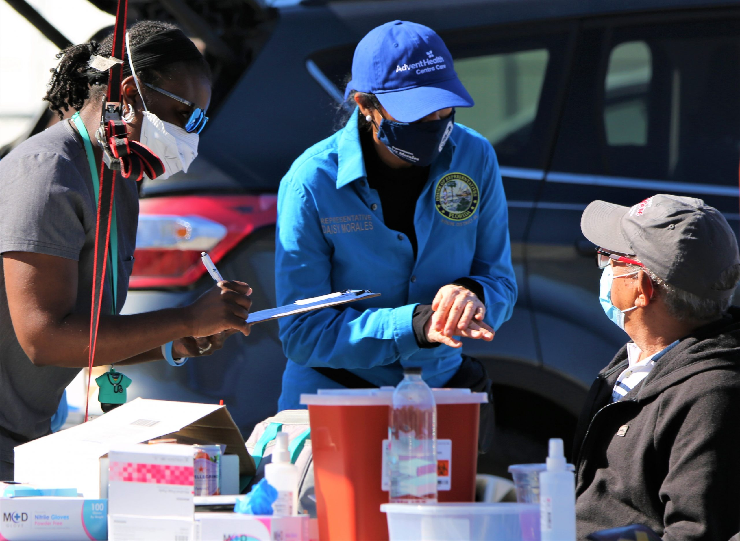 State Representative Daisy Morales assists frontline health care workers with Spanish speaking residents at a District 48 COVID-19 vaccination site in central Orlando, Saturday, February 20, 2021. (Photo by Florida National News / J Willie David, III)