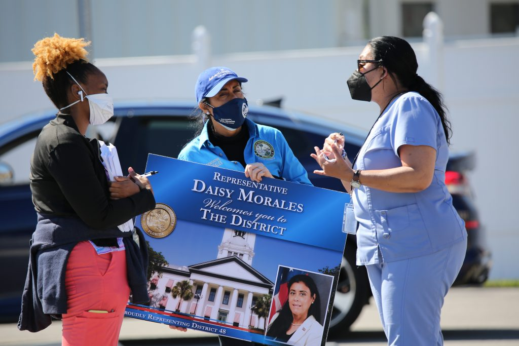 State Representative Daisy Morales talks with frontline health care workers at a District 48 COVID-19 vaccination site in central Orlando, Saturday, February 20, 2021. (Photo by Florida National News / J Willie David, III)