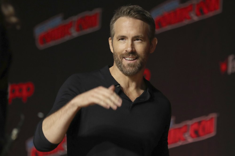 FILE - This Oct. 3, 2019 file photo shows Ryan Reynolds at New York Comic Con. Hollywood actors Ryan Reynolds and Rob McElhenney are officially the new owners of Welsh soccer club Wrexham, according to a formal takeover announcement Wednesday Feb. 10, 2021, (AP Photo/Steve Luciano, File)