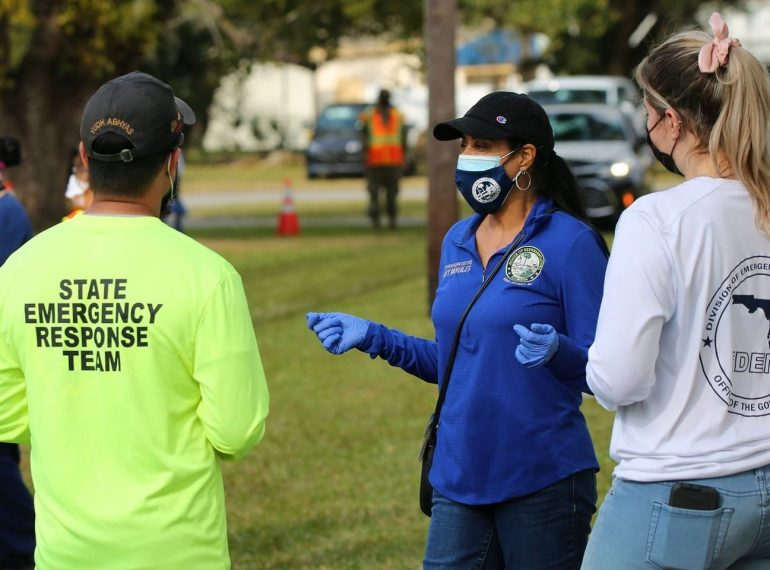 State Rep. Daisy Morales talks with Florida Division of Emergency Management staff at an event in January 2021. Photo: Florida Representative Daisy Morales (Facebook).