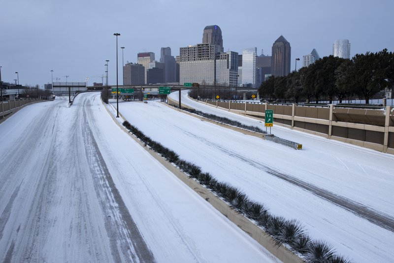With sparse traffic on the road, snow and ice cover US 75 heading into downtown Dallas on Monday, Feb. 15, 2021. (Juan Figueroa/The Dallas Morning News via AP)