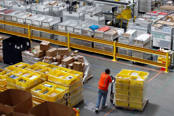 Warehouse worker takes inventory. Photo: AP.