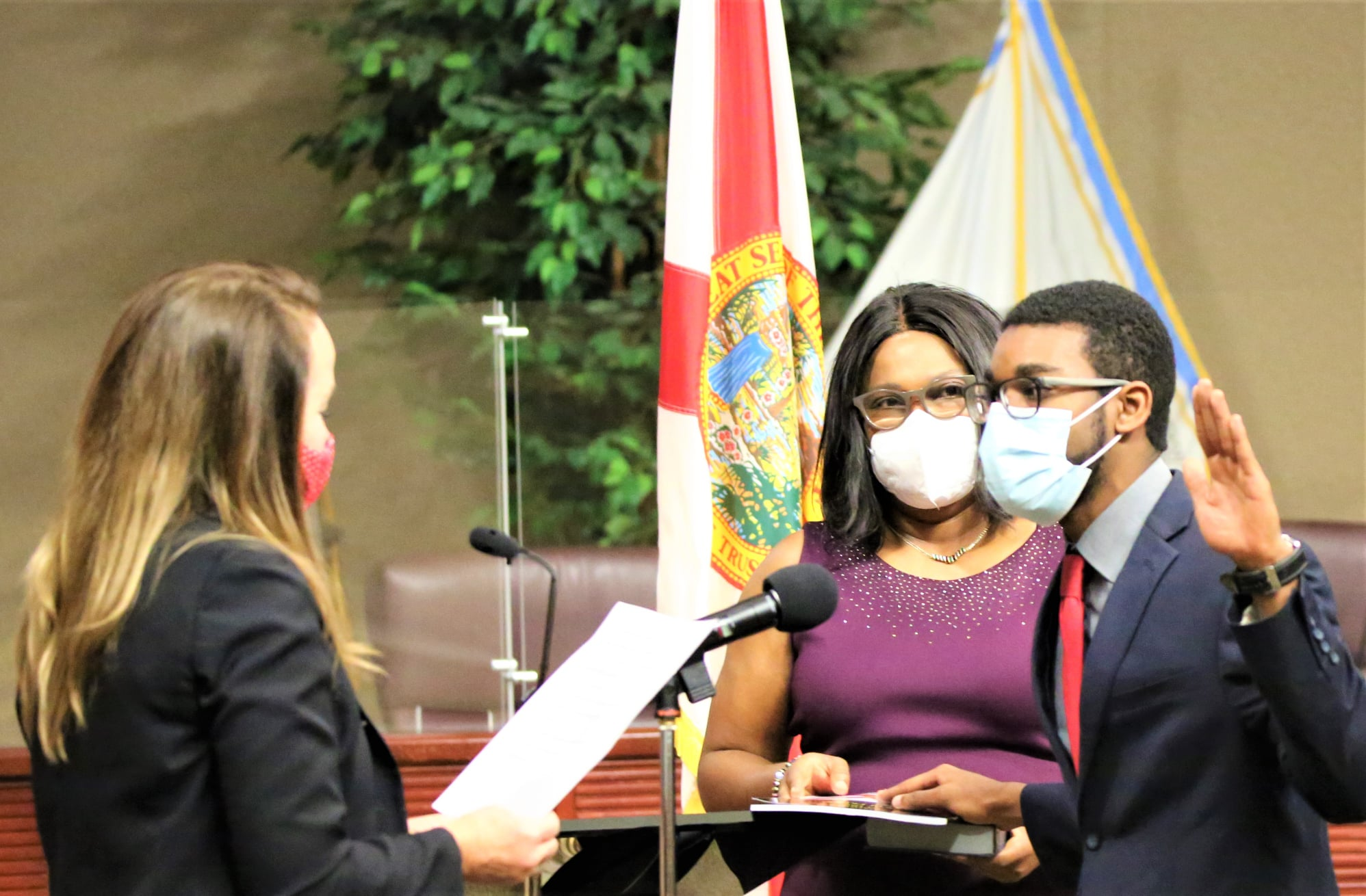 Newly elected Orange Soil & Water Conservation District Supervisor Nate Douglas gets sworn in by newly elected County Commissioner Nicole Johnson on December 28, 2020 in the Orange County Commission Chambers. Photo: Willie David/Florida National News.