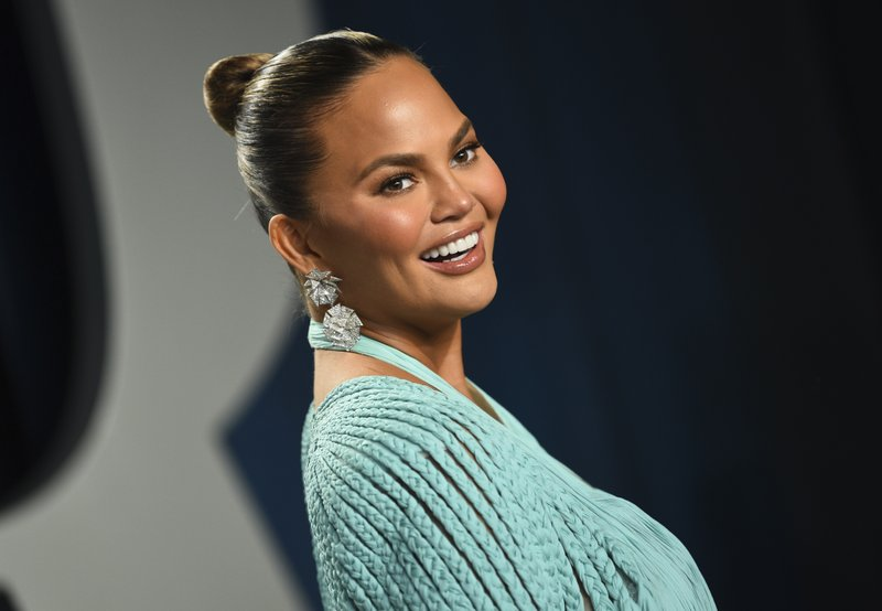FILE - In this Feb. 9, 2020, file photo, Chrissy Teigen arrives at the Vanity Fair Oscar Party in Beverly Hills, Calif. Teigen has deleted her popular Twitter account, saying the site no longer plays a positive role in her life and has become a negative part on her life. (Photo by Evan Agostini/Invision/AP, File)