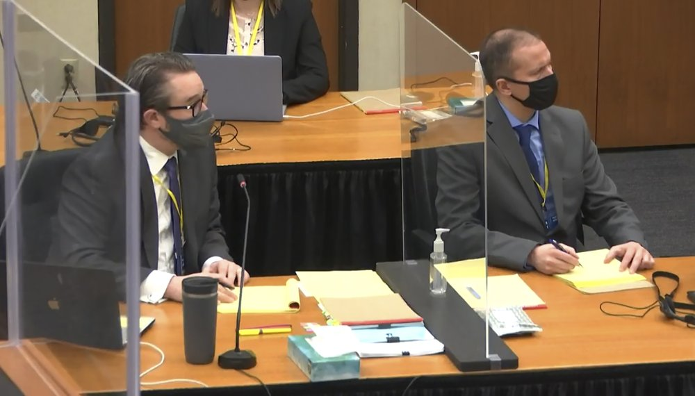 In this screen grab from video, defense attorney Eric Nelson, left, and defendant and former Minneapolis police officer Derek Chauvin, right, listen as Hennepin County Judge Peter Cahill discusses pre-trial motions, prior to continuing jury selection, Friday, March 19, 2021, at the Hennepin County Courthouse in Minneapolis, Minn. Chauvin is charged in the May 25, 2020 death of George Floyd. (Court TV via AP, Pool)