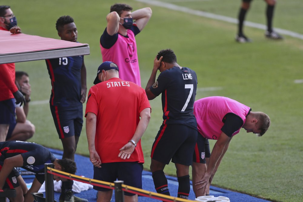 United States' players react at the bench during a Concacaf Men's Olympic qualifying championship semi-final soccer match against Honduras in Guadalajara, Mexico, Sunday, March 28, 2021. (AP Photo/Fernando Llano)