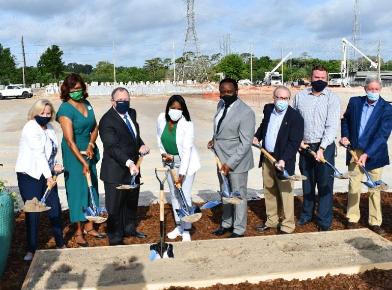Wendover Housing Partners founder and CEO Jonathan Wolf (3rd from left), Orange County District 6 Commissioner Victoria Siplin (center, in white), Orange County Mayor Jerry Demings (center, in gray) and other community partners broke ground on the new senior living center in Pine Hills which is projected to be completed at the end of 2021. Photo: Juan Carlo Rodriguez/Florida National News.
