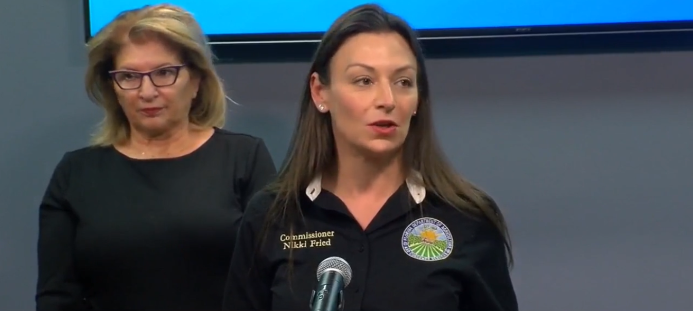 Florida Commissioner of Agriculture Nikki Fried addresses the media during a press conference at the Manatee County Emergency Operations Center Tuesday afternoon as State Senator Janet Cruz looks on. Image: WFLA Channel 8 (screen capture).