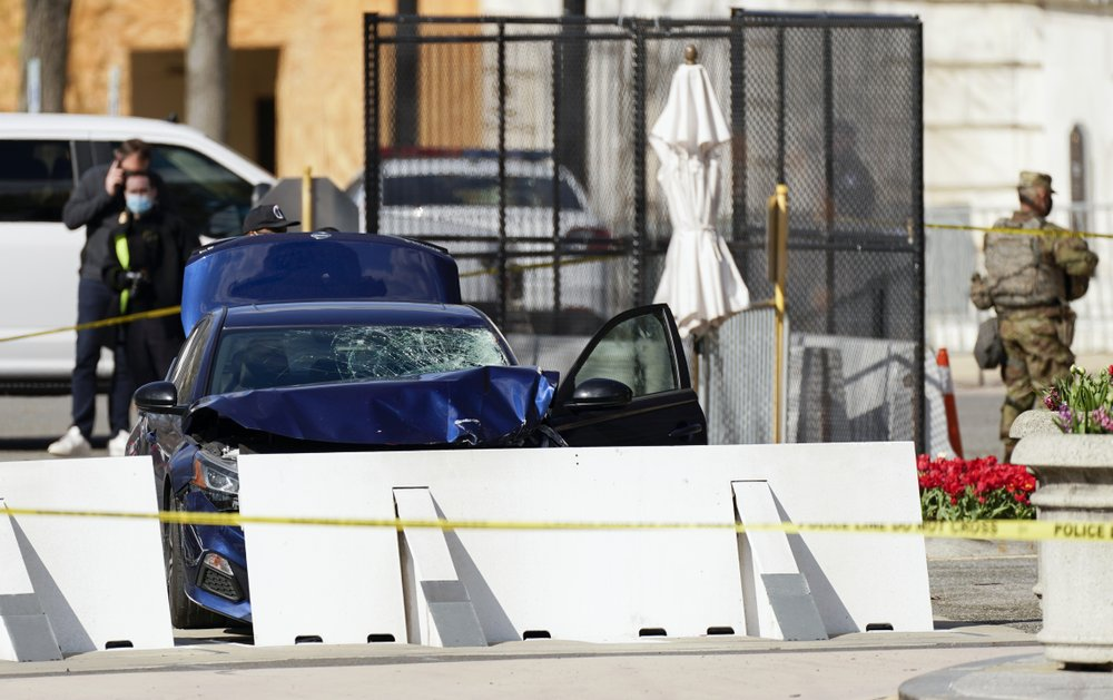 The car that crashed into a barrier on Capitol Hill is seen near the Senate side of the U.S. Capitol in Washington, Friday, April 2, 2021. (AP Photo/Carolyn Kaster)