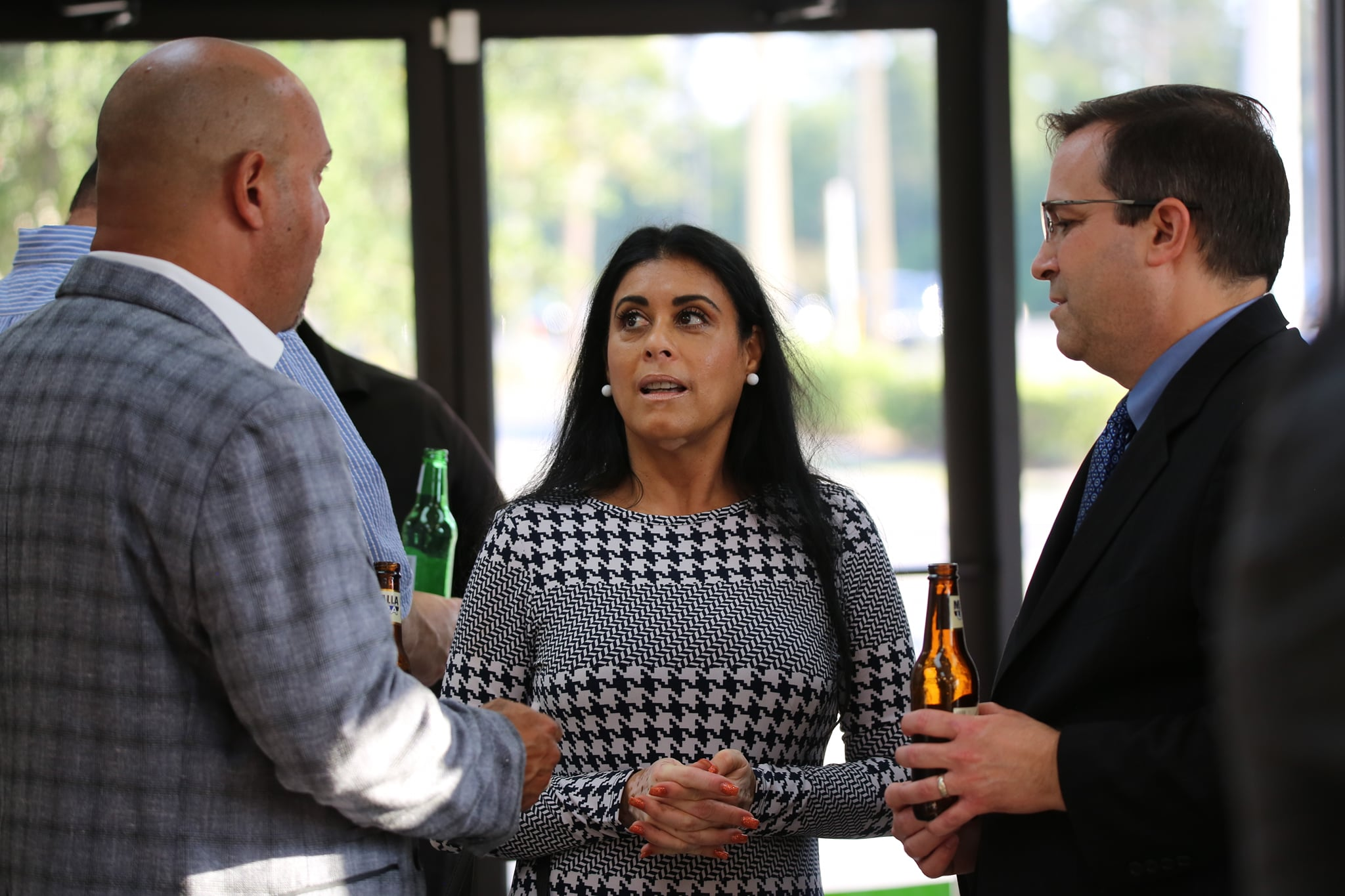 Florida State Representative Daisy Morales speaks with Orlando Gateway District's Board President Dennis Ferraro (right) and Executive Director Amilcar Cordova on supporting and funding business growth in her district. (District 48). Photo: Willie David/Florida National News.