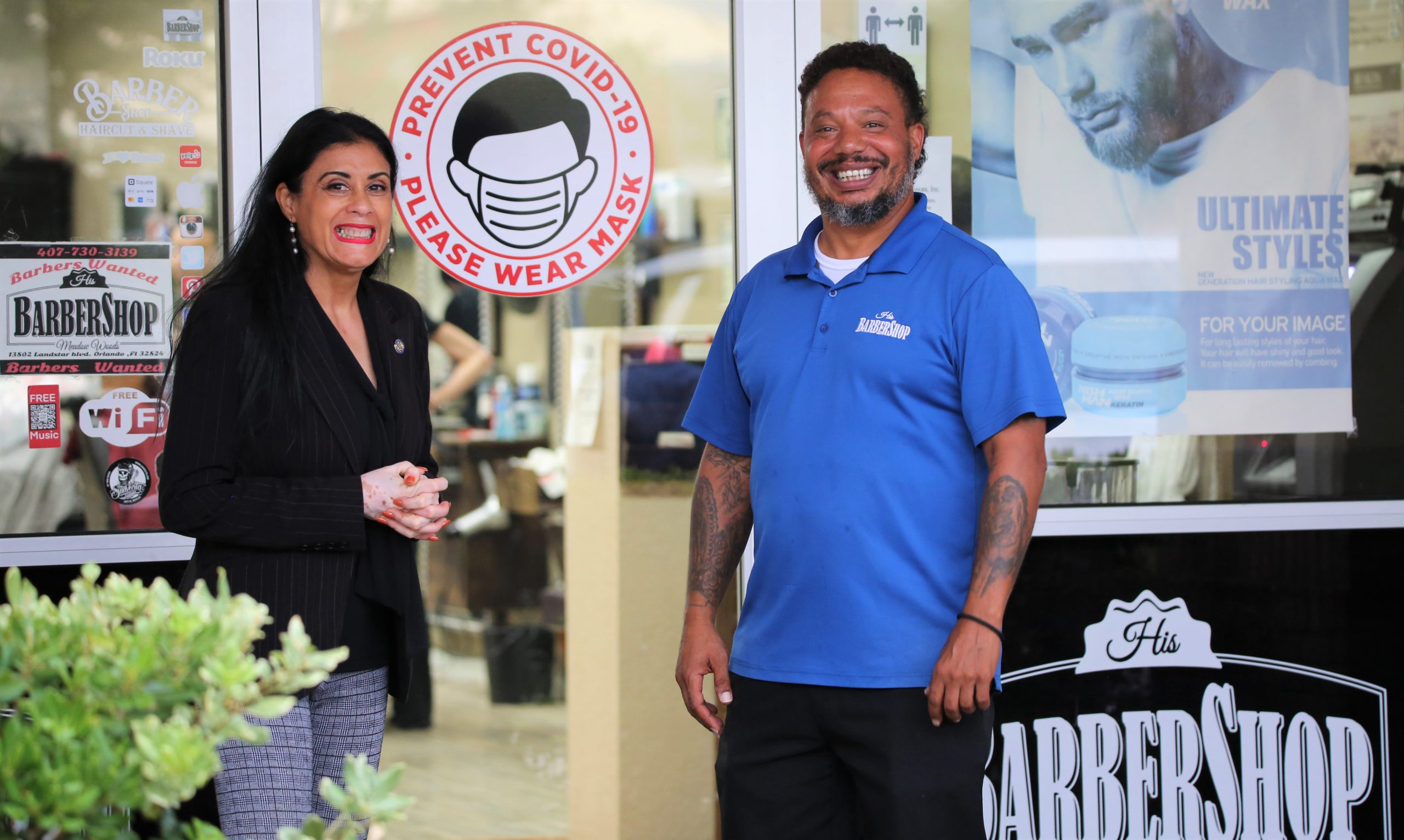 State Rep. Daisy Morales talks with barbershop owners in the community about President Biden's Shots in the Shop initiative. Photo courtesy of State Rep. Daisy Morales.