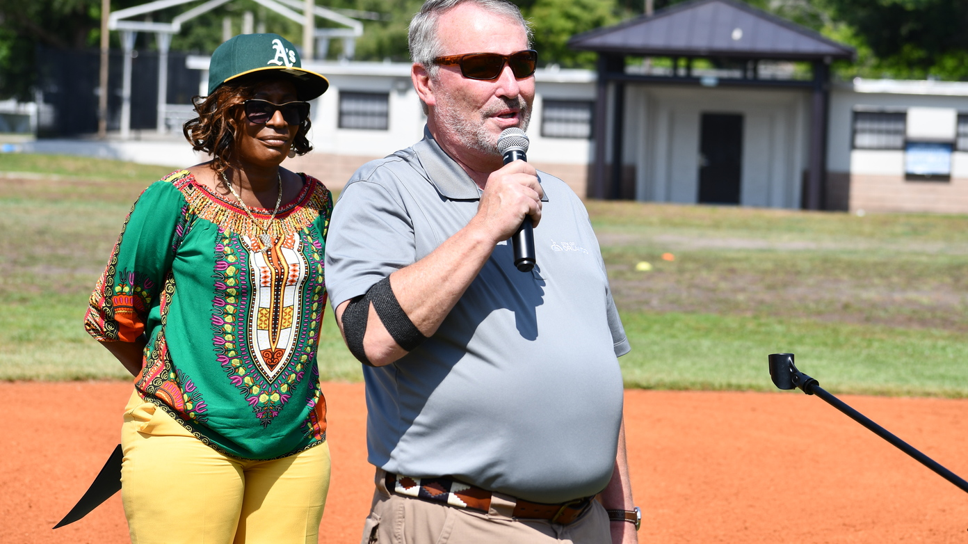 Orlando District 5 Commissioner Regina Hill and Orlando Mayor Buddy Dyer kick off the city's youth baseball program. Photo: Juan Carlo Rodriguez/Florida National News.