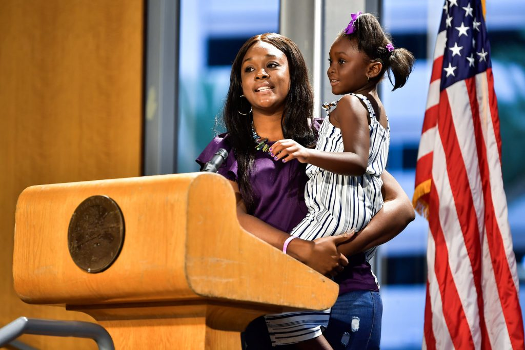 Dallas (right), a five-year-old diagnosed with vitiligo a year prior, offered encouraging words for others who also have the disease. Photo: Harry Castiblanco/Florida National News.