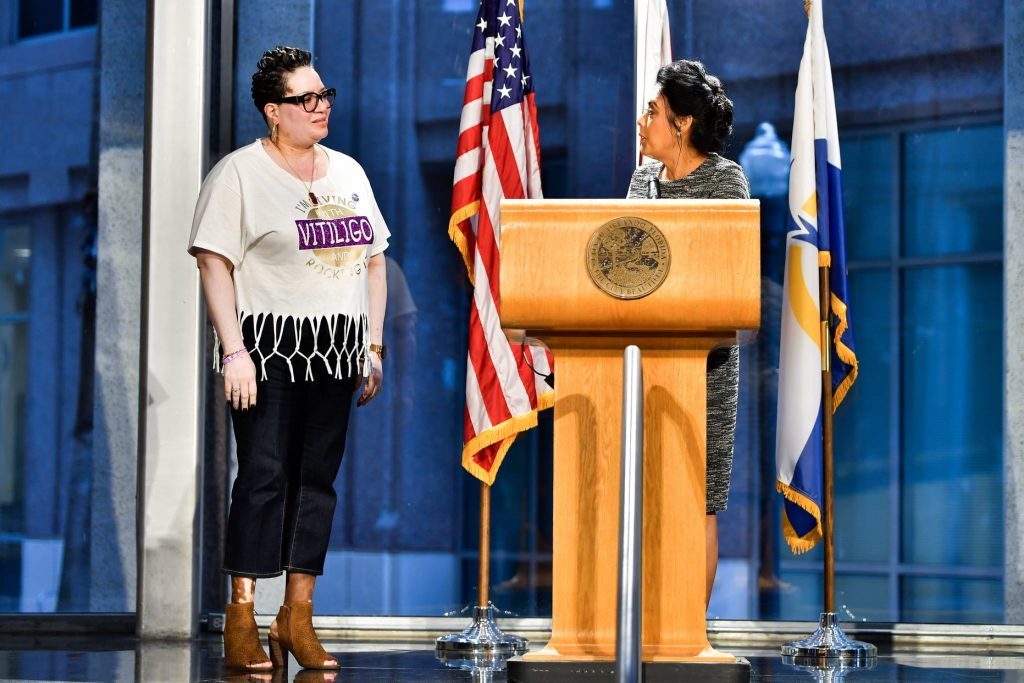 State Representative Daisy Morales (right) presents Beautifully Unblemished founder Tonja Johnson with a certificate of appreciation at the close of her inaugural World Vitiligo Day event at Orlando City Hall Friday, June 25, 2021. Photo: Harry Castiblanco/Florida National News.