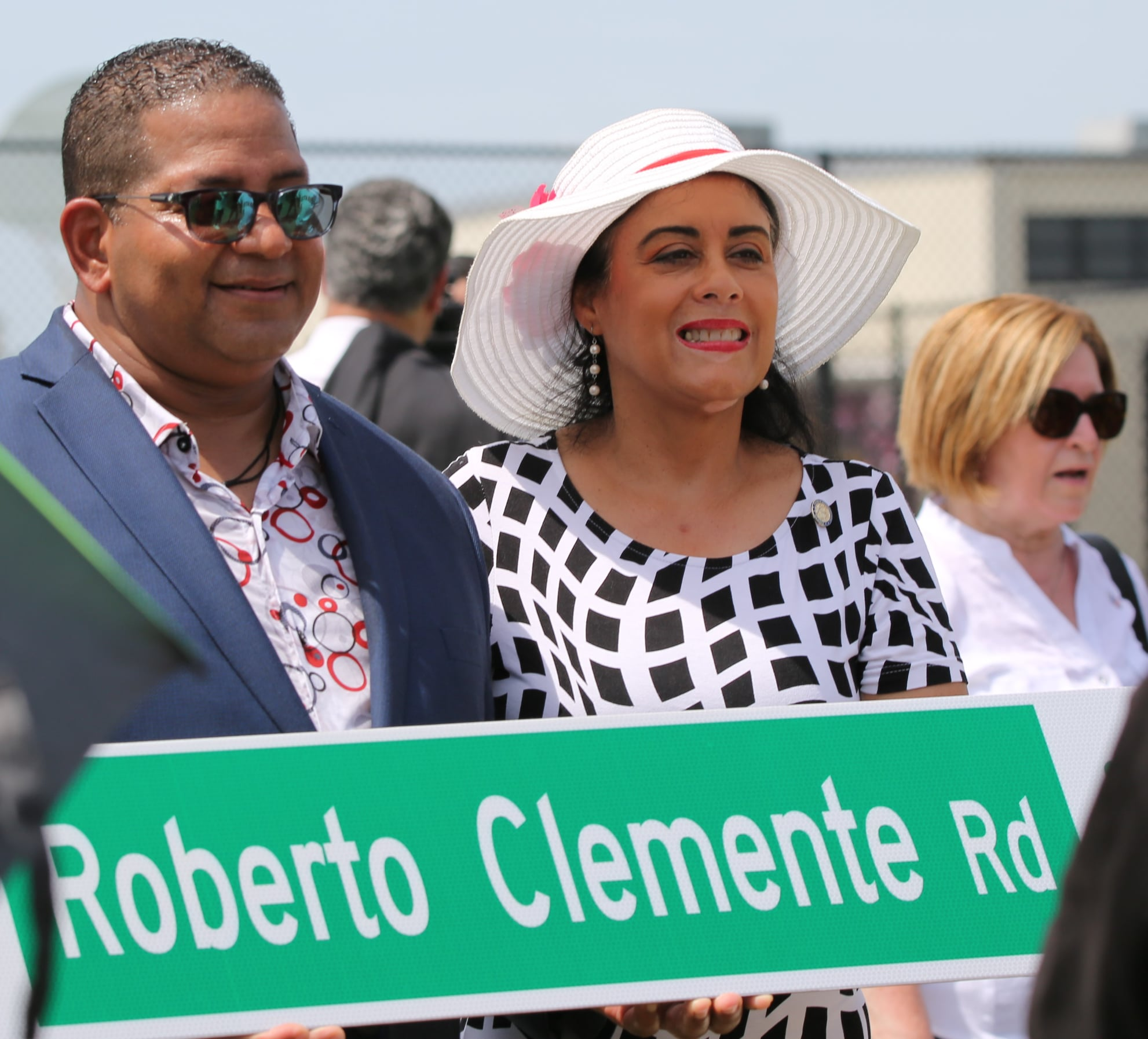 State Rep. Daisy Morales celebrates wirh Luis Clemente, son of Roberto Clemente, during the street sign unveiling Wednesday, June 23, 2021. Photo courtesy of State Rep. Morales.