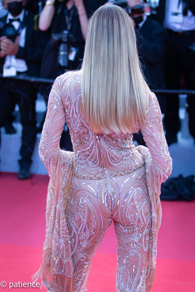 The back view of supermodel Candice Swanepoel's Etra sequined catsuit at the 2021 Cannes Film Festival Opening Night red carpet. Photo: Patience Eding/Another Concept via Florida National News.