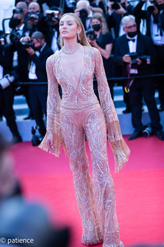 The full body view of supermodel Candice Swanepoel's Etra sequined catsuit at the 2021 Cannes Film Festival Opening Night red carpet. Photo: Patience Eding/Another Concept via Florida National News.