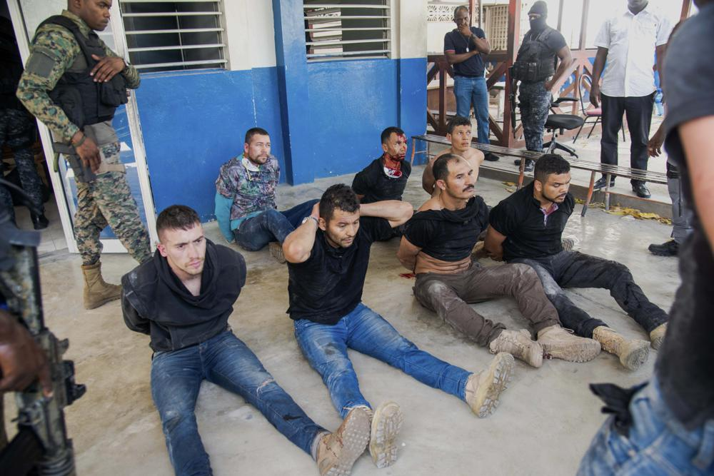 Police guard detained suspects in the assassination of Haiti's President Jovenel Moise at the General Direction of the police in Port-au-Prince, Haiti, Thursday, July 8, 2021. Moïse was assassinated in an attack on his private residence early Wednesday. (AP Photo/Jean Marc Hervé Abélard)