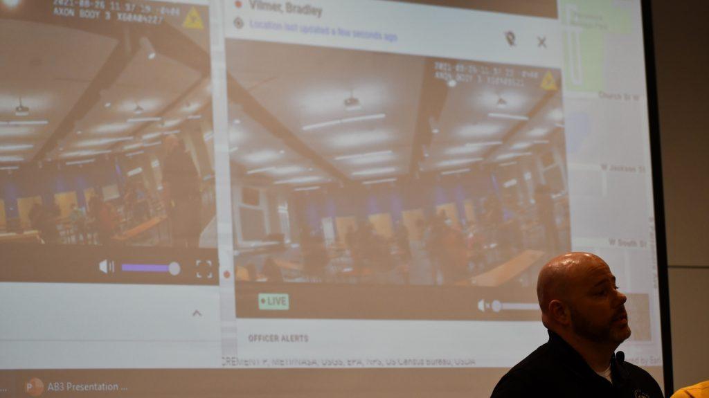 Officer Bradley Vilmer demonstrates the new body cam's livestreaming function. Photo: Juan Carlo Rodriguez/Florida National News.