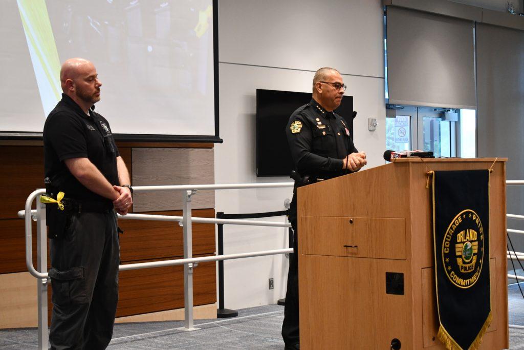 Orlando Police Officer Bradley Vilmer (left) and Chief Rolón present the new Axon 3 body cams. Photo: Juan Carlo Rodriguez/Florida National News.