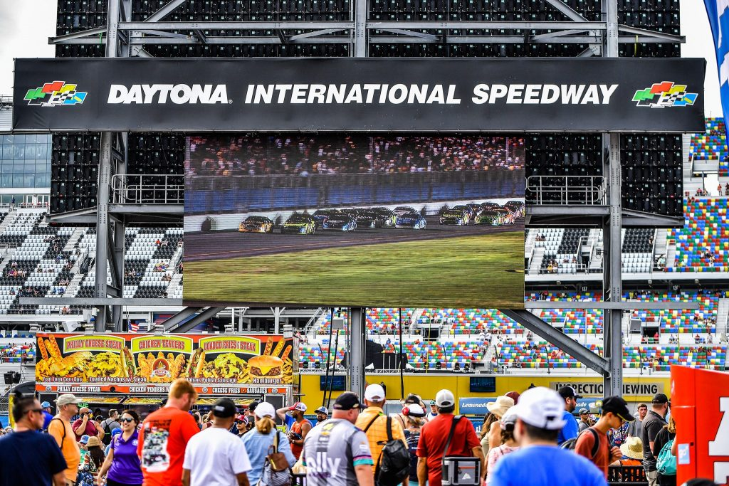 Fans watched replays of the Wawa 250 on the big screen as they await the Coke Zero Sugar 400 at Daytona International Speedway Saturday, August 28, 2021. Photo: Harry Castiblanco/Florida National News.
