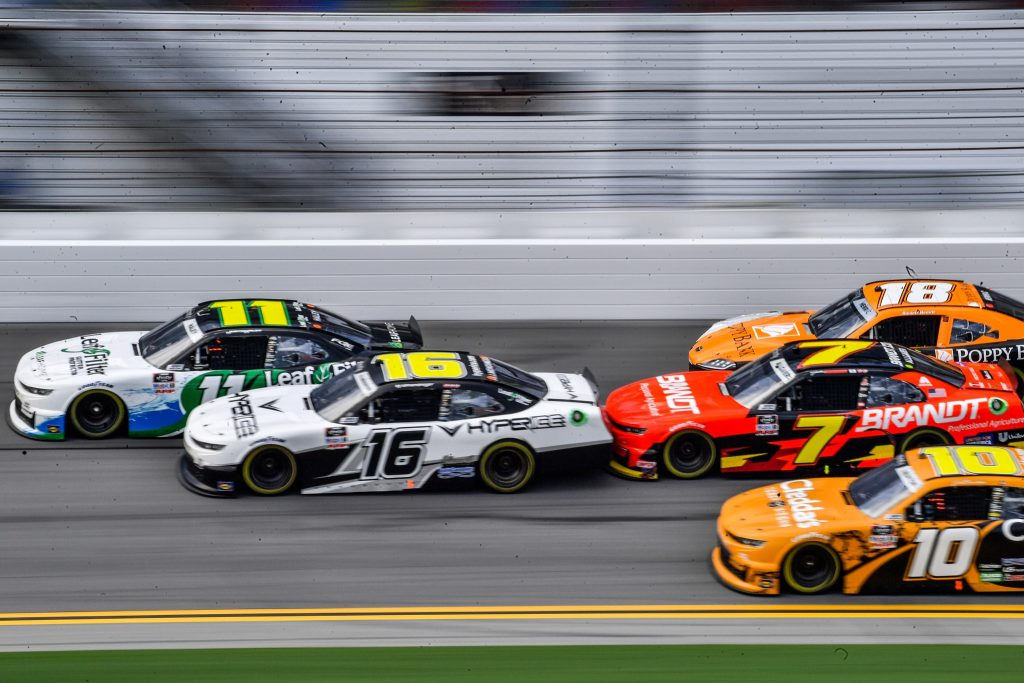 Haley (#11) just barely passes Allmendinger (#16) as they near the checkered line during the Wawa 250 at Daytona International Speedway Saturday, August 28, 2021. Photo: Harry Castiblanco.