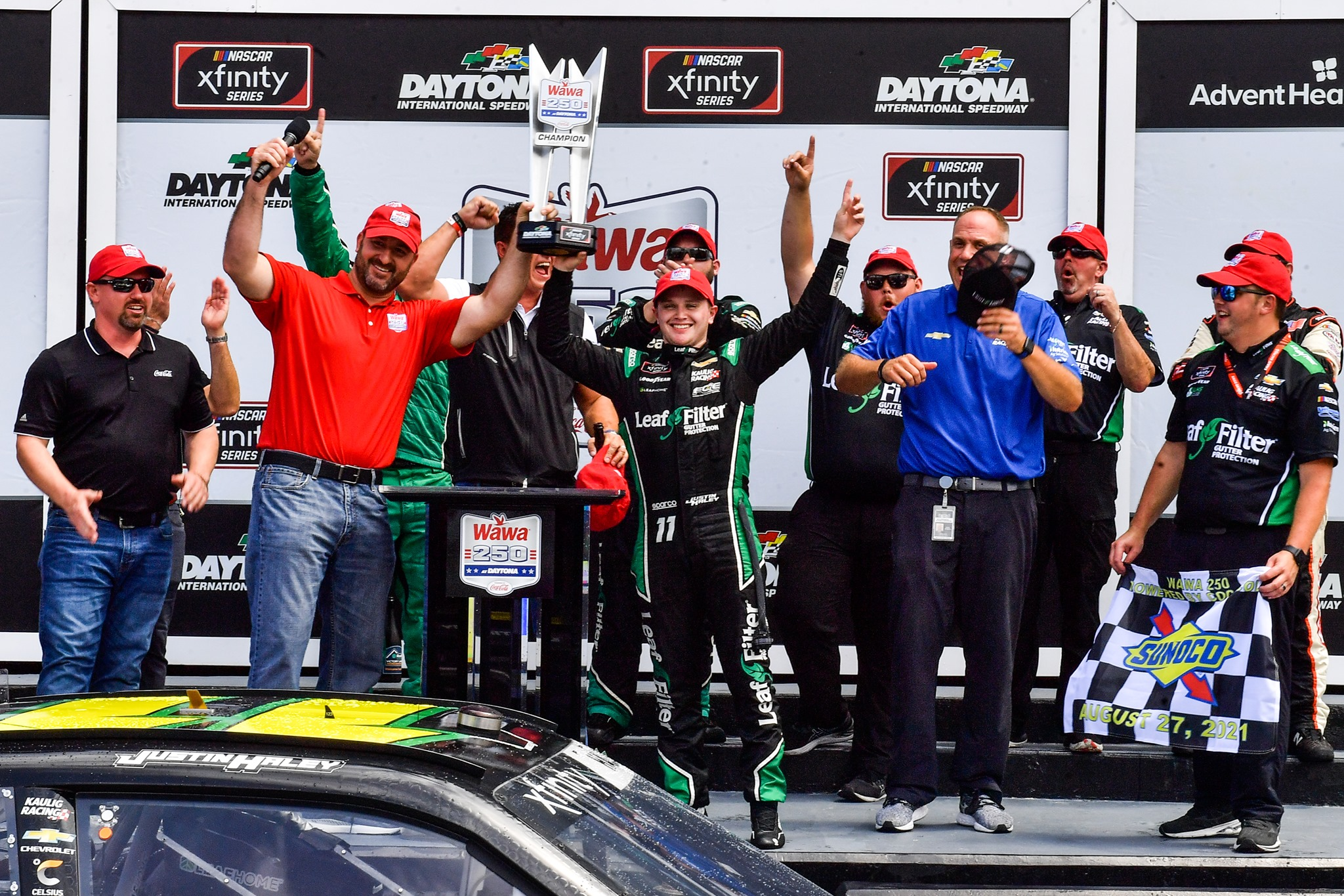Justin Haley raises the Wawa 250 trophy with friends in the Ruoff Mortgage Victory Lane at Daytona International Speedway after winning the Wawa 250 Saturday, August 28, 2021. Photo: Harry Castiblanco/Florida National News.